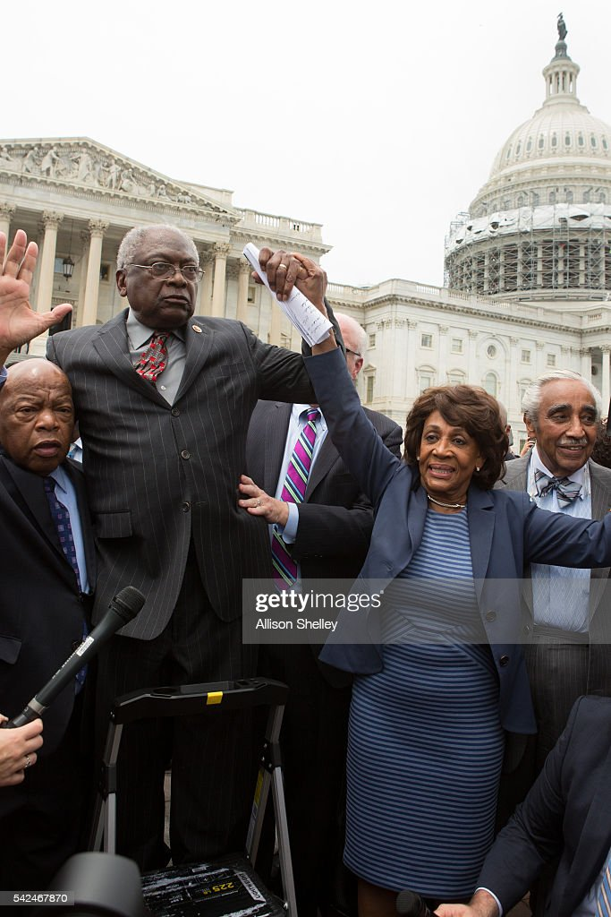 Reps. John Lewis (D-GA), James Clyburn (D-SC), Maxine Waters (D-CA) and Charles Rangel, (D-NY) speak with supporters outside the U.S. Capitol building June 23, 2016 in Washington, DC. Democratic House members ended their overnight House floor sit-in trying to force a vote on gun control legislation.