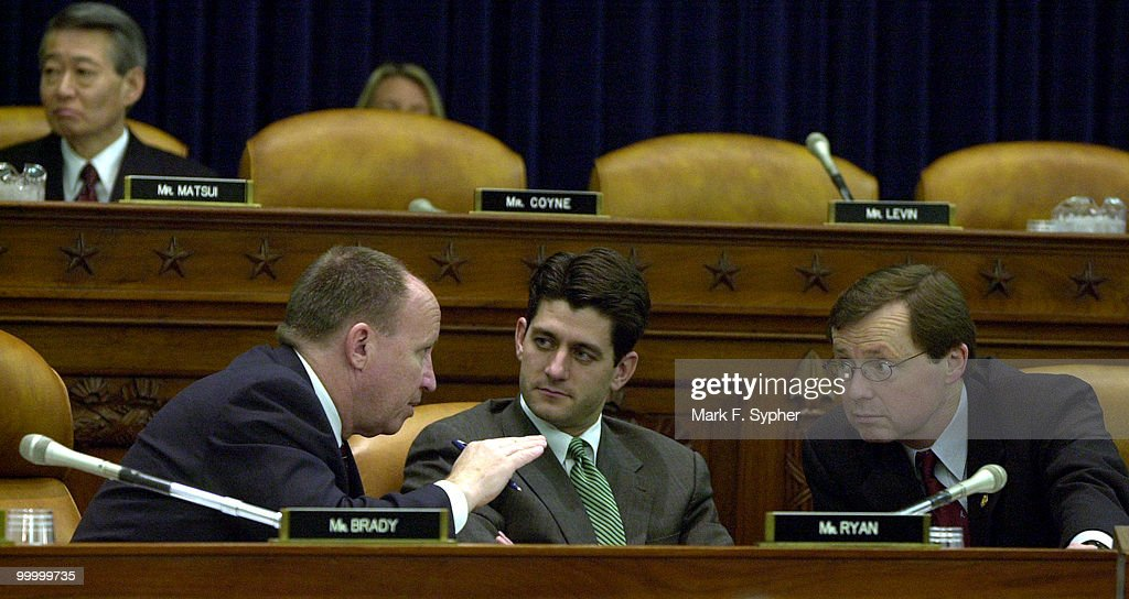 Reps. Kevin K. Brady (R-TX), Paul D. Ryan (R-WI), and Earl Pomeroy (D-ND) talk at a Ways and Means Committee Hearing on Retirement Security and Defined Contribution Plans hearing on Tuesday in the Longworth House Office Building, after someone made a joke about the Enron scandal, calling it the 'e word.'