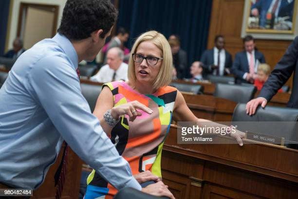 Reps Kyrsten Sinema DAriz and Trey Hollingsworth RInd talk before a House Financial Services Committee hearing in Rayburn Building titled Oversight...