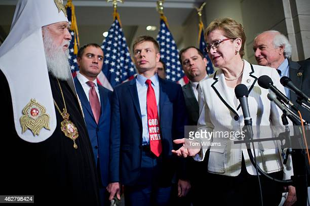 Reps Marcy Kaptur DOhio and Sander Levin DMich right conduct a news conference in the Capitol Visitor Center with Patriarch Filaret left of the...