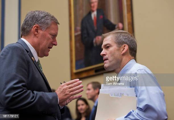 Reps Mark Meadows RNC left and Jim Jordan ROhio talk before a House Oversight and Government Reform Committee hearing in Rayburn titled Reviews of...