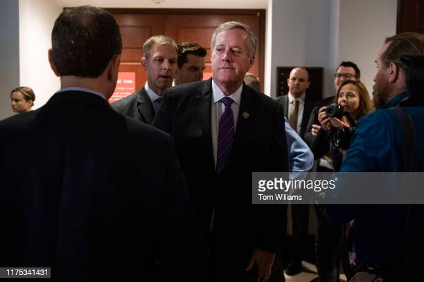 Reps Mark Meadows RNC right passes House Intelligence Chairman Adam Schiff DCalif left outside a meeting in the Capitol Visitor Center where Gordon...