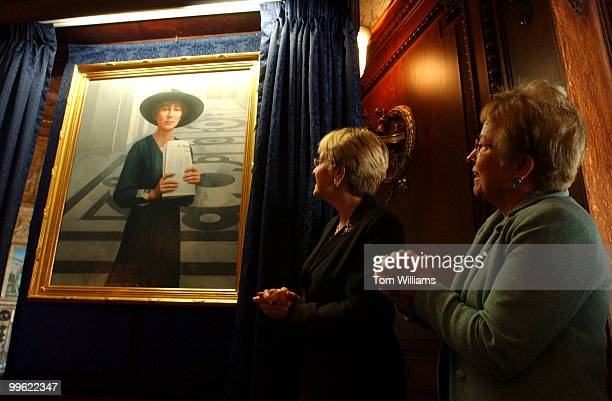Reps Nancy Johnson RConn right and Marcy Kaptur DOhio admire the portrait of Jeannette Rankin of Monatana who was the first woman elected to Congress...