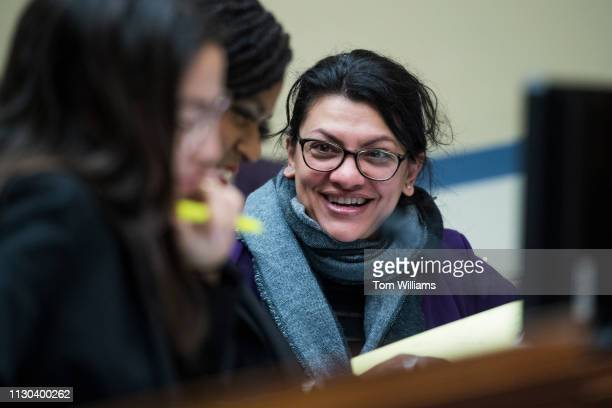 Reps Rashida Tlaib DMich right Alexandria OcasioCortez DNY left and Ayanna Pressley DMass are seen during a House Oversight and Reform Committee...