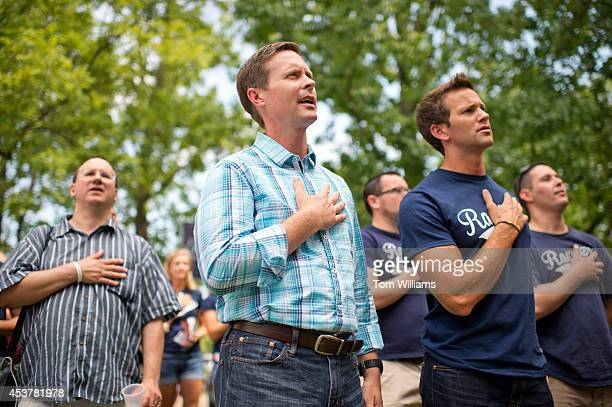 Reps Rodney Davis RIll center and Aaron Schock RIll recite the Pledge of Allegiance during Republican Day at the Illinois State Fair in Springfield...