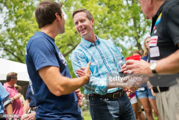 Reps Rodney Davis RIll right and Aaron Schock RIll attend Republican Day at the Illinois State Fair in Springfield Ill August 14 2014