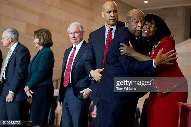 Reps Terri Sewell DAla and John Lewis DGa embrace during a ceremony in the Capitol Visitor Center's Emancipation Hall for the Foot Soldiers of the...