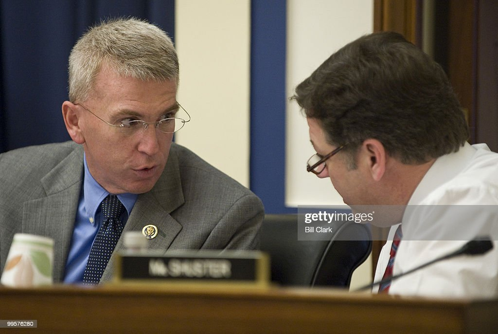 Reps. Todd Platts, left, and Bill Shuster, both Republicans from Pennsylvania, talk during the Water Resources and Environment Subcommittee hearing on 'The One Year Anniversary of the Tennessee Valley Authority's (TVA) Kingston Ash Slide on Wednesday, Dec. 9, 2009.