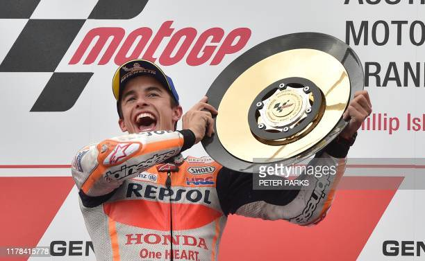 TOPSHOT Repsol Honda MotoGP rider Marc Marquez of Spain holds up the trophy after winning the Australian motorcycle Grand Prix at Phillip Island on...