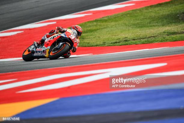 Repsol Honda spanish rider Marc Marquez rides his bike during a qualifying session for the San Marino Moto GP Grand Prix race at the Marco Simoncelli...