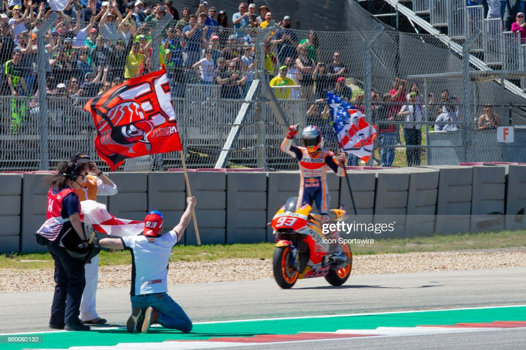Repsol Honda Team Marc Marquez (93) holds a flag salutes to the crowd after the MotoGP Red Bull U.S. Grand Prix of The Americas - Championship at Circuit of The Americas on April 22, 2018 in Austin, Texas.
