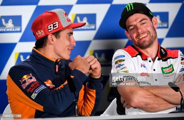 Repsol Honda Team MotoGP rider Marc Marquez of Spain shares a light moment with LRC Castrol Honda rider Cal Crutchlow of Britain during a press...