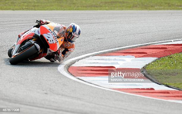 Repsol Honda Team rider Dani Pedrosa of Spain takes a corner during the 2014 Malaysian MotoGP motorcycle Grand Prix at the Sepang International...