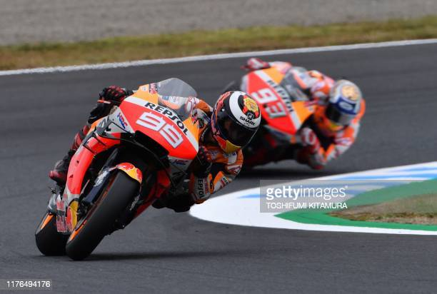 Repsol Honda Team rider Jorge Lorenzo of Spain leads teammate Marc Marquez of Spain during the second free practice session at the Twin Ring Motegi...