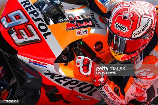 Repsol Honda Team rider Marc Marquez of Spain speeds through a corner during the third MotoGP free practice at the Sepang International Circuit on...