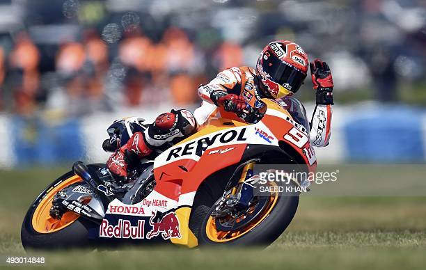 Repsol Honda Team rider Marc Marquez of Spain waves to crowd at the end of the third practice session ahead of the MotoGP Australian Grand Prix at...