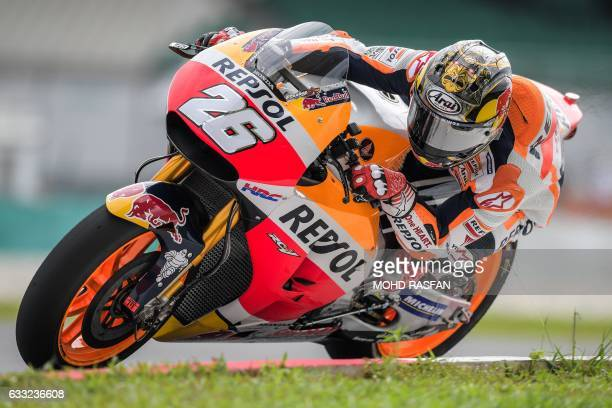 TOPSHOT Repsol Honda Team Spanish rider Dani Pedrosa steers his bike after taking a corner during the last day of 2017 MotoGP preseason test at the...