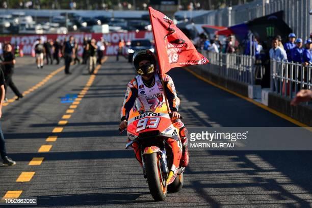 Repsol Honda Team Spanish rider Marc Marquez arrives in the pits of the MotoGP Japanese Grand Prix at Twin Ring Motegi circuit in Motegi Tochigi...