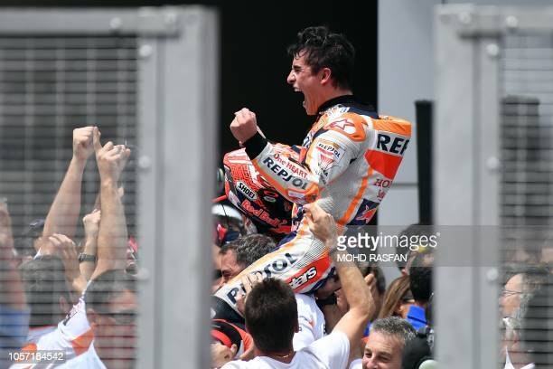 TOPSHOT Repsol Honda Team Spanish rider Marc Marquez celebrates after winning the Malaysia MotoGP at the Sepang International Circuit in Sepang on...