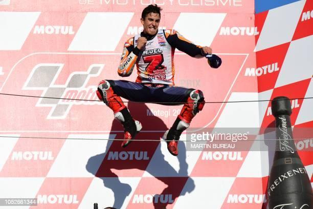 TOPSHOT Repsol Honda Team Spanish rider Marc Marquez celebrates on the podium of the MotoGP Japanese Grand Prix at Twin Ring Motegi circuit in Motegi...