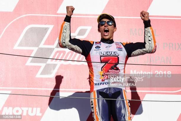 Repsol Honda Team Spanish rider Marc Marquez celebrates on the podium of the MotoGP Japanese Grand Prix at Twin Ring Motegi circuit in Motegi Tochigi...