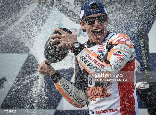 Repsol Honda Team Spanish rider Marc Marquez celebrates on the podium after winning the MotoGP race for the Thailand Grand Prix at Buriram...