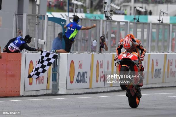 Repsol Honda Team Spanish rider Marc Marquez celebrates winning the Malaysia MotoGP at the Sepang International Circuit in Sepang on November 4 2018