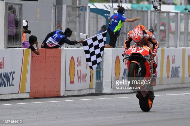 TOPSHOT Repsol Honda Team Spanish rider Marc Marquez celebrates winning the Malaysia MotoGP at the Sepang International Circuit in Sepang on November...