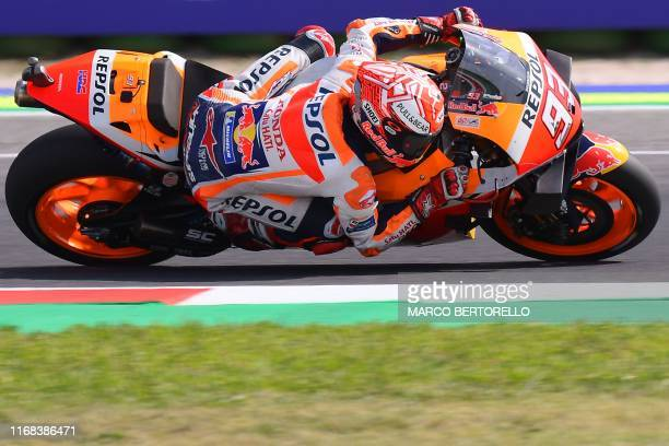 Repsol Honda Team Spanish rider, Marc Marquez competes on his way to win the San Marino MotoGP Grand Prix race at the Misano World Circuit Marco...
