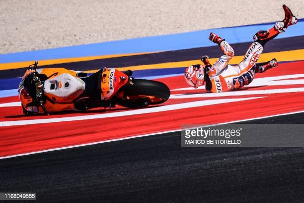 Repsol Honda Team Spanish rider, Marc Marquez falls during a free practice session ahead of the San Marino MotoGP Grand Prix race at the Misano World...