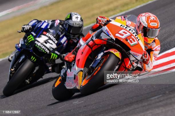 Repsol Honda Team Spanish rider, Marc Marquez , followed by Monster Energy Yamaha Spanish rider, Maverick Vinales, competes on his way to win the San...