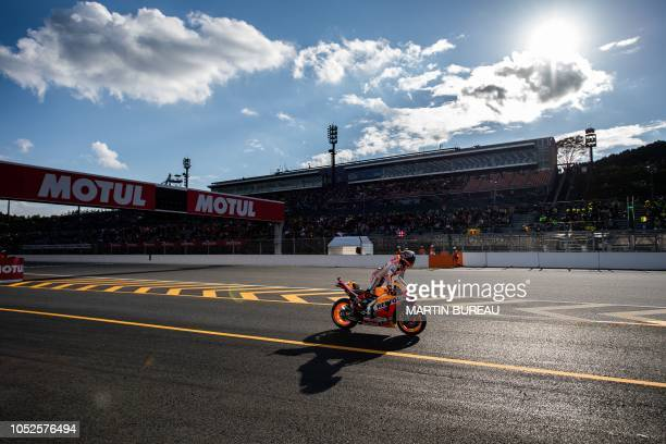 Repsol Honda Team Spanish rider Marc Marquez leaves the pits during the qualifying session of the MotoGP Japanese Grand Prix at Twin Ring Motegi...