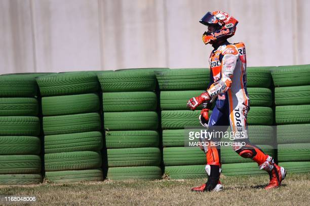 Repsol Honda Team Spanish rider, Marc Marquez leaves the track after falling during a free practice session ahead of the San Marino MotoGP Grand Prix...