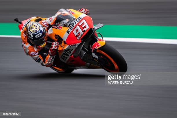 TOPSHOT Repsol Honda Team Spanish rider Marc Marquez participates in the first practice session ahead of the MotoGP Japanese Grand Prix at Twin Ring...