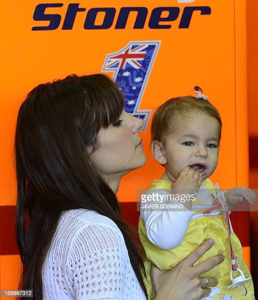 Repsol Honda team's Australian rider Casey Stoner's wife Adriana and daughter Alessandra stand inside the pit during the third MotoGP free practice...