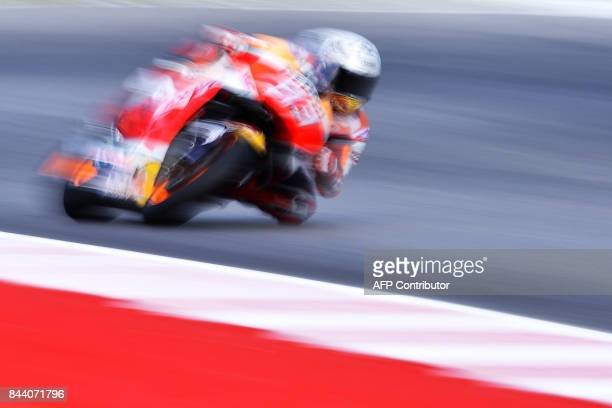 Repsol Honda Team's Marc Marquez from Spain practices at the Marco Simoncelli Circuit in Misano on September 8 ahead of the San Marino Moto Grand...