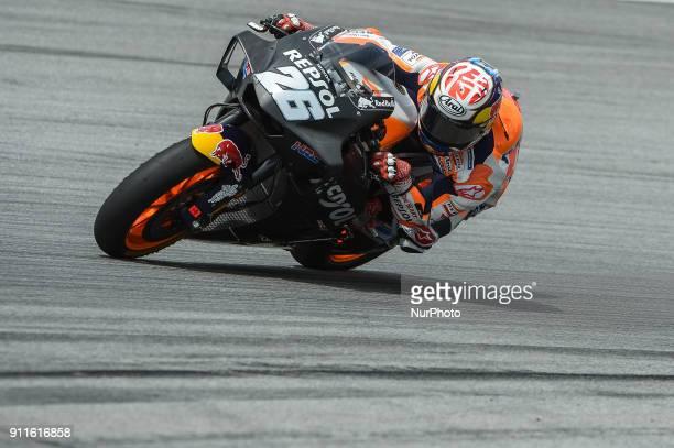 Repsol Honda Team's rider Dani Pedrosa of Spain powers his bike during the second day of the 2018 MotoGP preseason test at the Sepang International...