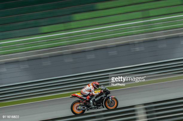 Repsol Honda Team's rider Marc Marquez of Spain powers his bike during the second day of the 2018 MotoGP preseason test at the Sepang International...