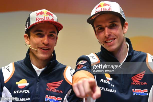 Repsol Honda Team's Spanish MotoGP driver Marc Marquez and his brother teammate Alex attend the presentation of the new Repsol Honda team in Madrid...
