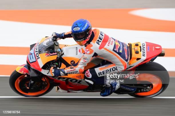 Repsol Honda Team's Spanish rider Alex Marquez takes part in the qualifying session of the MotoGP Valencia Grand Prix at the Ricardo Tormo circuit in...