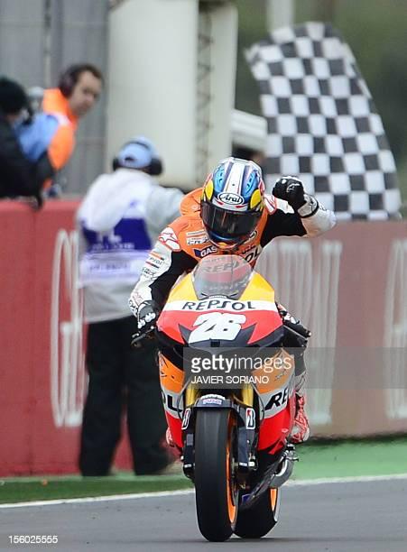 Repsol Honda team's spanish rider Dani Pedrosa celebrates after crossing the finish line of the MotoGP race of Valencia's Grand Prix at Ricardo Tormo...