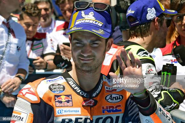 Repsol Honda Team's Spanish rider Dani Pedrosa celebrates being second placed during the MotoGP qualifying session of the Spanish Grand Prix at the...