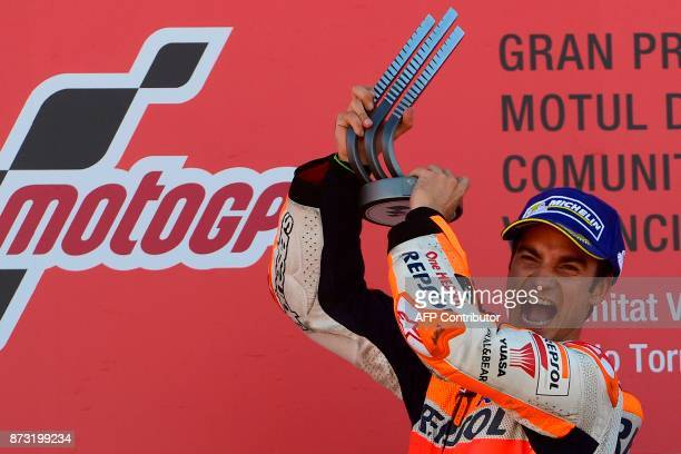 Repsol Honda Team's Spanish rider Dani Pedrosa celebrates on the podium after winning the MotoGP race of the Valencia Grand Prix at Ricardo Tormo...