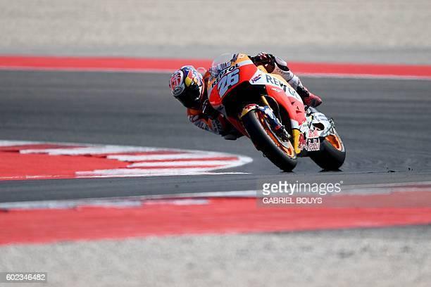 Repsol Honda Team's Spanish rider Dani Pedrosa competes to win the San Marino Moto GP Grand Prix race at the Marco Simoncelli Circuit in Misano on...