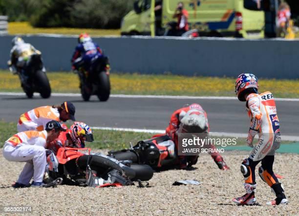Repsol Honda Team's Spanish rider Dani Pedrosa looks at Ducati Team's Italian rider Andrea Dovizioso and Ducati Team's Spanish rider Jorge Lorenzo...