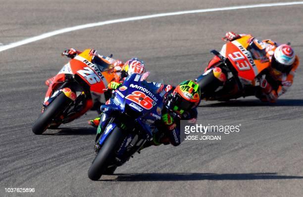 Repsol Honda Team's Spanish rider Dani Pedrosa Movistar Yamaha MotoGP's Spanish rider Maverick Vinales and Repsol Honda Team's Spanish rider Marc...