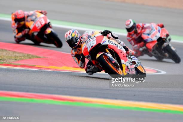 Repsol Honda Team's Spanish rider Dani Pedrosa rides ahead of Ducati Team's Spanish rider Jorge Lorenzo and Repsol Honda Team's Spanish rider Marc...