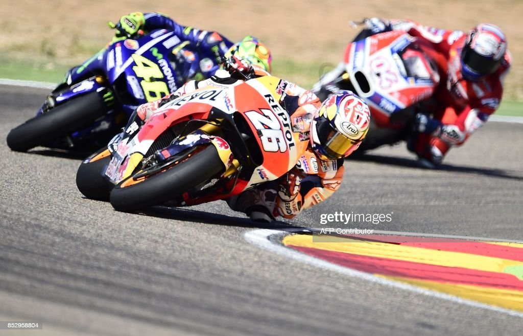 Repsol Honda Team's Spanish rider Dani Pedrosa (C) rides during MotoGP race of the Moto Grand Prix of Aragon at the Motorland circuit in Alcaniz on September 24, 2017. /