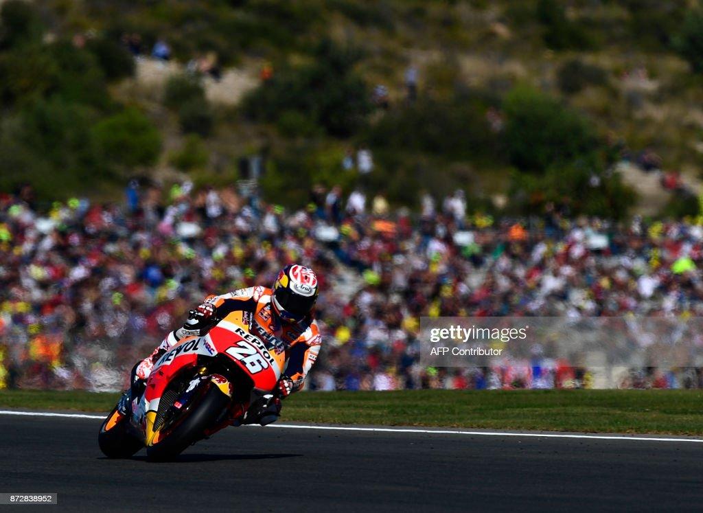 Repsol Honda Team's Spanish rider Dani Pedrosa rides during the fourth MotoGP free practice session of the Valencia Grand Prix at Ricardo Tormo racetrack in Cheste, near Valencia on November 11, 2017. /