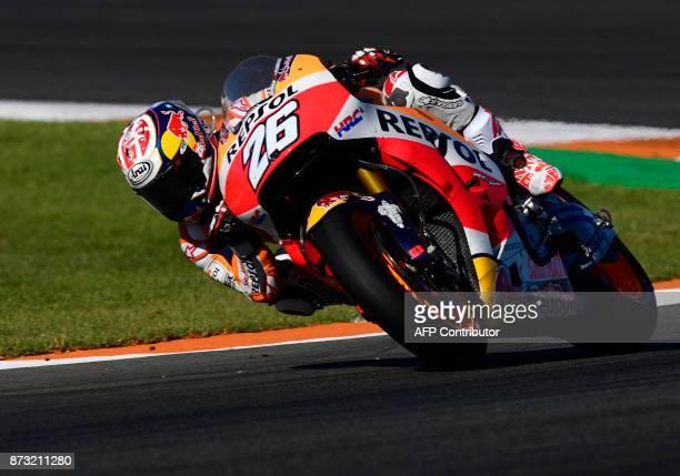 Repsol Honda Team's Spanish rider Dani Pedrosa rides during the MotoGP race of the Valencia Grand Prix at Ricardo Tormo racetrack in Cheste near...